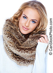 Gorgeous blond woman wearing fur scarf and smiling -...