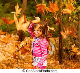 Little girl in autumn forest - Photo of little cute girl...