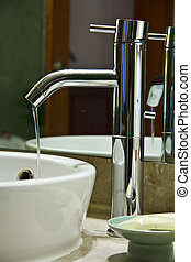 Sanitary ware - Silver chrome bathroom tap faucets running...