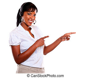 Young female wearing a headphones looking at you and...