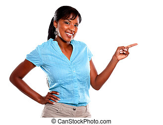 Adult woman looking at you and pointing to left on blue...