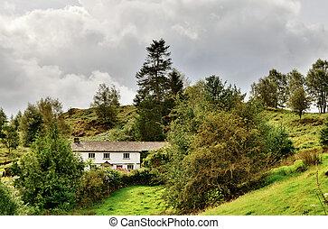 Whitewashed Lakeland Cottage on a Hillside