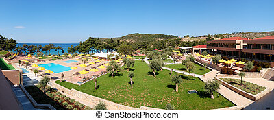 Panorama of swimming pools and beach at the luxury hotel, Thassos island, Greece