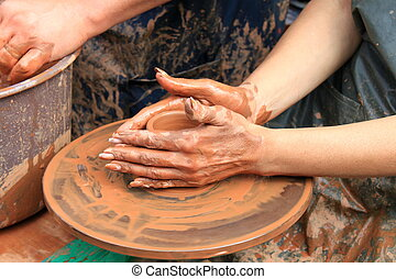 hands of a potter close-up