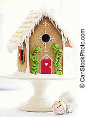 Gingerbread house on a cakestand