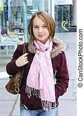 Teenage girl shopping - Teenage girl window shopping on city...