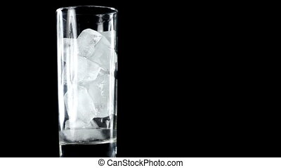 Melting ice in glass