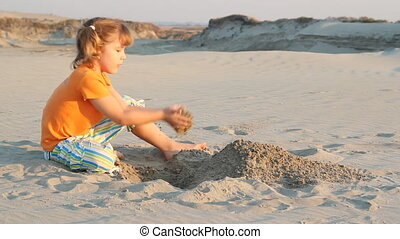 little girl play in sand