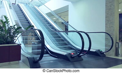 Escalators moving in different directions