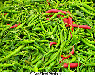 Green and red chilli peppers close up detail view