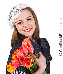 Cute brunette girl with tulip flowers