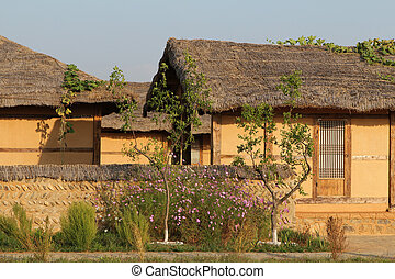 rural scene - traditional asian clay village house in rural...