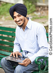 Young adult indian sikh man - Portrait of Indian sikh man in...