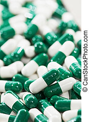 white green capsule pills with medicine antibiotic -...