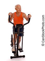 Senor Workout - Senior man working otu on an eliptical zero...