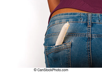 Menstruation concept: tight jeans and a tampon