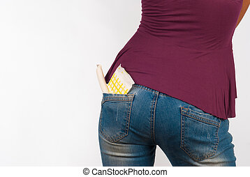 Panty liner and tampon sticking out of jeans pocket