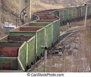 Train in motion - Coal wagons on railway tracks