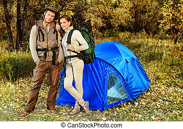 recreation - Happy couple having a rest outdoor in tent.