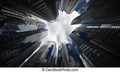 Skyscrapers over blue sky, seamless loop