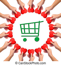 "Conceptual image, giving heart to ""green shopping"". Hands..."