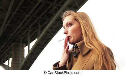 girl smoking and talking