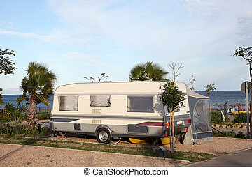 Caravan on a camping site by the sea
