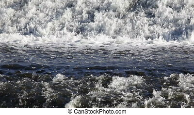 Water Flowing - Close-up of a small waterfall on a river