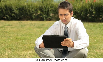 Summer business - Young office worker with touchpad...