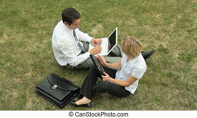 Open air office - The above-view of business partners doing...