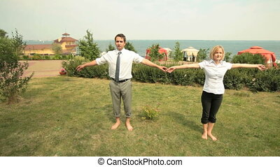 Business asanas - Business team performing a complex of...
