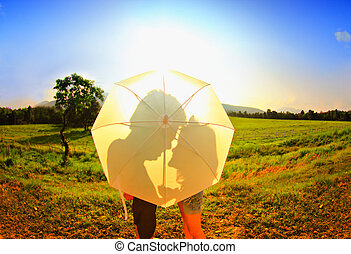 Romantic scene of love the shade of umbrella white.