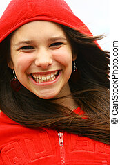 Smiling teenager with a red hood