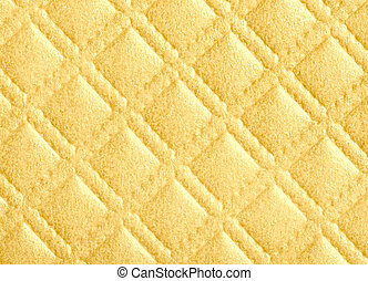 detail of  diamond pattern texture in gold color