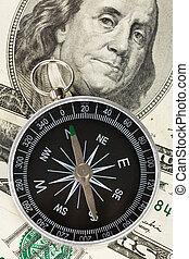 Compass and dollar close up shot