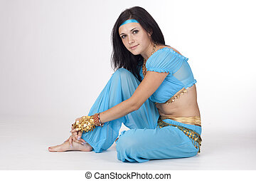 Beautiful  Eastern belly  girl in eastern dancing blue clothes, isolated.