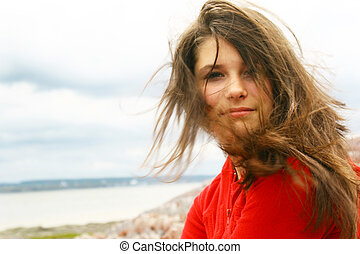 Windy day - Beautiful teenager with wind in the hair