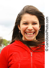 Smiling teenager with a red sweater