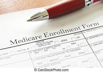 Medicare - Closeup of Medicare enrollment form and pen