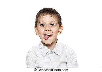 Happy child put out his tongue isolated on white background