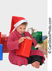 Christmas Morning - Young happy boy opening a present on...