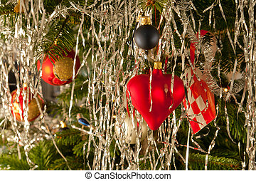 Christmas decoration balls and hearts on a tree
