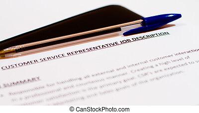 Job Description document and pen on black leather case