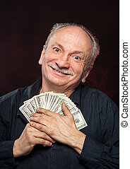 Lucky old man with dollar bills - Lucky old man holding with...