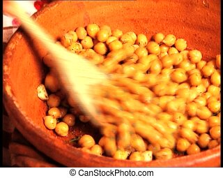 FOOD chickpeas stirred wooden spoon - Stirring boiled...