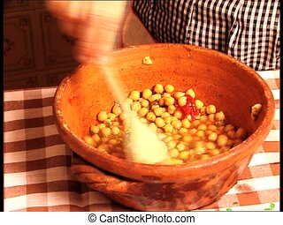 FOOD chickpeas stirred with tomato - Mixing boiled chickpeas...