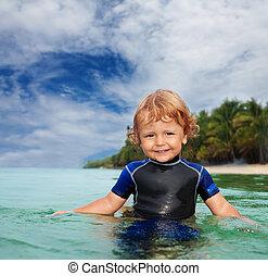 Happy toddler in wet suit