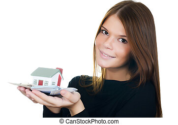 The woman with the toy house and banknotes