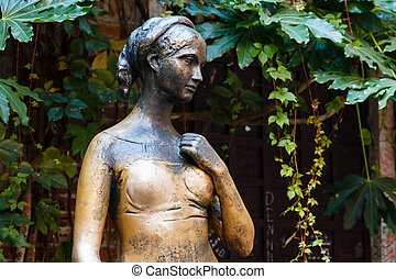 Statue of Juliet Capulet in Her House Backyard in Verona,...