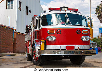 Fire Truck - A Shiny Red Fire Truck In Action Outdoor